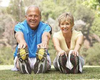 Senior-Couple-Exercising-In-Park